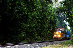 A Union Pacific Freight train pulls through the crossing at historic Funks Grove Illinois just off of Route 66.  The railcars carrying containers are pulled by engine 5431 and 5757.  Engine 5431 is a GE C45ACCTE (ES44AC) with an operating weight of 416,000 lbs. and engine 5757 is a GE C44ACCTE (AC4400CW) with 4400 horsepower .