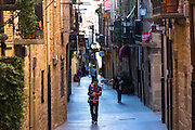 People strolling in Basque town of Laguardia in Rioja-Alavesa area of Spain