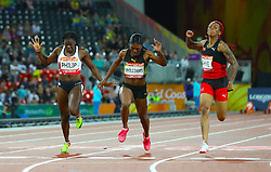 (left to right) England's Asha Philip, Jamaica's Christania Williams and Trinidad and Tobago's Michelle-Lee Ahye cross the finish line in the Women's 100m Final at the Carrara Stadium during day five of the 2018 Commonwealth Games in the Gold Coast, Australia.