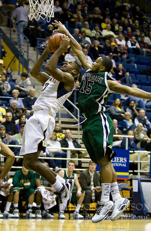 December 28, 2009; Berkeley, CA, USA;  Utah Valley Wolverines guard Tyray Petty (15) blocks a shot from California Golden Bears guard Patrick Christopher (23) during the first half at the Haas Pavilion.  California defeated Utah Valley 85-51.