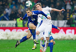 Ognjen Vranjes of BIH vs Robert Beric of Slovenia during friendly football match between National teams of Slovenia and Bosna and Herzegovina, on February 6, 2013 in SRC Stozice, Ljubljana, Slovenia. BIH defeated Slovenia 3-0. (Photo By Vid Ponikvar / Sportida.com)