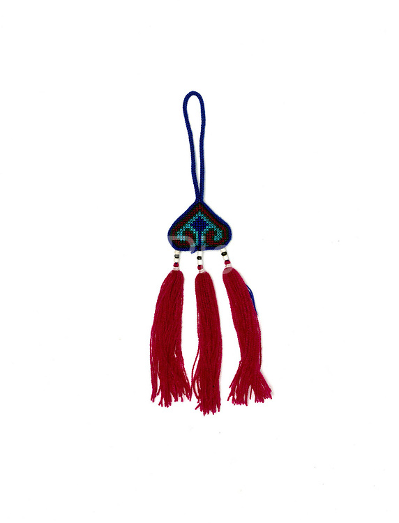 A handmade hanging decoration made by Yao ethnic minority women for selling to tourists in Ban Nammy village, Luang Namtha province, Lao PDR.