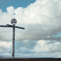 CAITHNESS, UK - April 2018:  Dubbed Scotland's Route 66, The North Coast 500 is a 516-mile (830 km) scenic route around the north coast of Scotland. Running through the traditional counties of Inverness-shire, Ross and Cromarty, Sutherland and Caithness, the route starts at Inverness and runs via Muir of Ord, Applecross (including the notorious Bealach na Bà), Gairloch, Ullapool, Durness, Thurso, John o'Groats, Wick, Dunrobin Castle, Dingwall then finally back to Muir of Ord and Inverness.  Pictured John o' Groats which lies on Britain's North Eastern tip and is popular with tourists as one end of the longest journey on the mainland, with Land's End in Cornwall lying 876 miles (1,410 km) to the southwest.