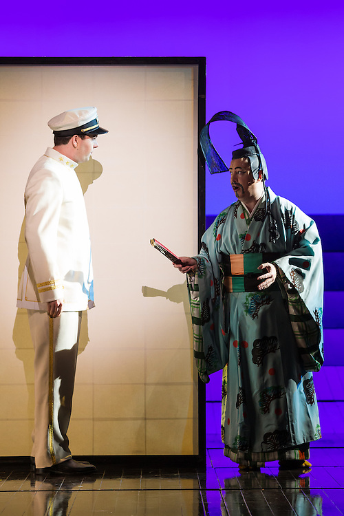 """LONDON, UK, 14 May, 2016. David Butt Philip (left, as Pinkerton) and Alun Rhys-Jenkins (right, as Goro) rehearse for the revival of director Anthony Minghella's production of Puccini's opera """"Madam Butterfly"""" at the London Coliseum for the English National Opera. The production opens on 16 May. Photo credit: Scott Rylander."""