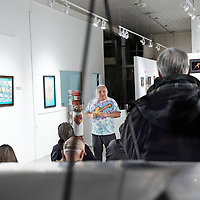 On Tuesday, Arnulfo Peña, 72, demonstrates his process to guests at the Art123 Gallery in Gallup.