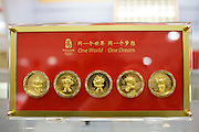 2008 Olympic Games Fuwa mascot characters medallion coins in souvenir shop, Wangfujing Street, Beijing, China