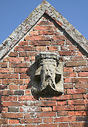 Weathering of medieval limestone carving suggesting effects of acid rain and carbonic acid, Covehithe church, Suffolk, England