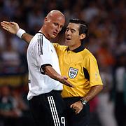 Germany's Carsten Janker offers some advice to Referee Ubaldo Aquino of Paraguay