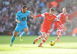 Southampton's Adam Lallana battles for the ball with Tottenham Hotspur's Michael Dawson - Photo mandatory by-line: Alex James/JMP - Tel: Mobile: 07966 386802 22/12/2013 - SPORT - FOOTBALL - St Mary's Stadium - Southampton - Southampton v Tottenham Hotspur - Barclays Premier League