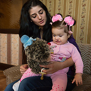 """CAPTION: """"I am a hairdresser"""", explains Armena. """"I would like Stella to grow up to be a hairdresser like me. My brother has said that he will gift a beauty salon to Stella when she's 18! He's here in Volgograd, and hopes to be richer in future and able to help Stella"""". LOCATION: Volgograd, Russia. INDIVIDUAL(S) PHOTOGRAPHED: Armena Vardanan (left) and Stella Aharonyan (right)."""