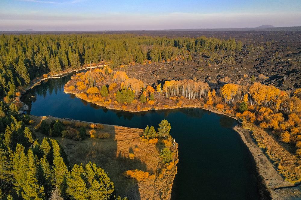 A drone's eye view of the Deschutes River, near Dillon Falls, reveals the lava rock landscape of Central Oregon.