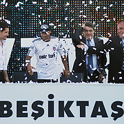 Besiktas Istanbul's new Portuguese soccer player Ricardo Quaresma (2ndL) and Besiktas president Yildirim Demiroren (R) poses for the media after signing a contract with Turkish soccer club Besiktas at Inonu stadium in Istanbul June 19, 2010.Photo by TURKPIX