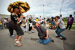 29 August 2014. Lower 9th Ward, New Orleans, Louisiana. <br /> Survivors of the storm. Ronald Favre leads a second line parade with residents, activists  and survivors in memory of those who perished in the storm 9 years ago. Photographed by Times Picayune's Ted Jackson and Nat Geo's Tyrone Turner.<br /> Photo; Charlie Varley/varleypix.com