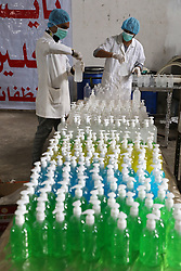 March 17, 2020, Gaza, Palestine: Palestinian workers work on the production line of sterilizing gel at a cleaning materials factory in the southern Gaza Strip city of Rafah. Gaza authorities declared a new set of precautionary measures amid concerns about the spread of the novel coronavirus in the coastal enclave. (Credit Image: © Majdi Fathi/NurPhoto via ZUMA Press)
