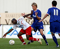Photo: Maarten Straetemans.<br /> Royal Antwerp v Ipswich Town. Pre Season Friendly. 31/07/2007.<br /> Dan Harding (right) of Ipswich with Kenmogne