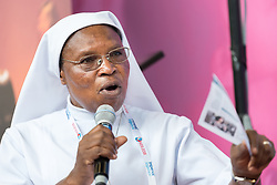 24 July 2018, Amsterdam, the Netherlands: Sister Elisabeth Vinyoh from Cameroon speaks during a workshop in the Interfaith Networking Zone, on what it means as a religious leader to get tested publicly for HIV, leading by example. On 23-27 July 2018 in Amsterdam, the Netherlands, the World Council of Churches - Ecumenical Advocacy Alliance in collaboration with faith and other partners hosts an Interfaith Networking Zone in the International AIDS Conference's Global Village area, providing a dynamic space for exchanges, resources and workshops. The Global Village is an integral part and recurring feature of the International AIDS Conference, and offers an accessible venue intended to strengthen the connection between the international conference and the local hosting community.
