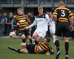 Falkirk's Jay Fulton tackled by Alloa Athletic's Jason Marr.<br /> Half time : Alloa Athletic 0 v 0 Falkirk, Scottish Championship 12/10/2013. played at Recreation Park, Alloa.<br /> ©Michael Schofield.