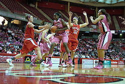 12 February 2012:  Despite efforts by MacKenzie Westscott, Candace Sykes brings down a rebound during an NCAA women's basketball game Where the Bradley Braves lost to the Illinois Sate Redbirds 82-63.  It was Play 4Kay day in honor of the cancer research fund set up by Coach Kay Yow at Redbird Arena in Normal IL