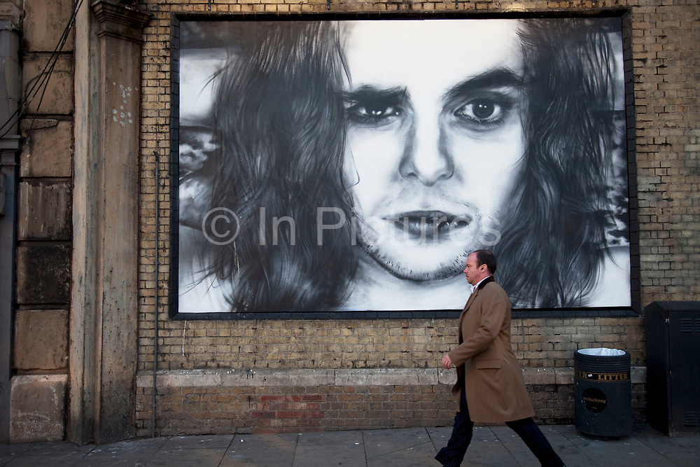 Street advertising art in Shoreditch, East London advertises the movie Killing Bond. This area is famed for it's creative, beautiful and poetic graffiti street art and this site is now used as a site for original, one off adverts.