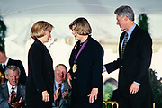 Museum of Modern Art president Agnes Gund is presented the National Medal of Arts by President Bill Clinton and First Lady Hillary Clinton during a ceremony on the South Lawn of the White House September 29, 1997 in Washington, DC.