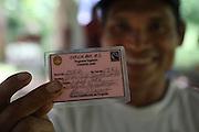 Dionisio Smith Smith, Ngäbe man and member of COCABO, displays his co-op member's card. COCABO: Valle de Agua Arriba, Almirante, Changuinola, Bocas del Toro, Panamá. September 1, 2012.