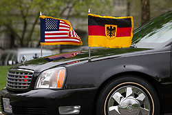 April 27, 2018 - Washington, DC, USA - U.S. and German flags are displayed on the limosine dropping Chancellor Angela Merkel at the White House. (Credit Image: © Michael Candelori via ZUMA Wire)