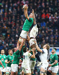 Ireland's Devin Toner (left) wins the ball in the lineout during the NatWest 6 Nations match at Twickenham Stadium, London.