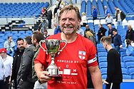 Spencer Pratten (Captain) of England over 60's with the Just International Cup at full time during the world's first Walking Football International match between England and Italy at the American Express Community Stadium, Brighton and Hove, England on 13 May 2018. Picture by Graham Hunt.