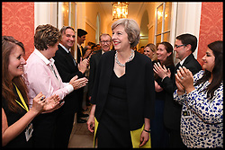 Image ©Licensed to i-Images Picture Agency. 13/07/2016. London, United Kingdom. Theresa May Becomes the New Prime Minister. The New British Prime Minister Theresa May with her husband Philip arrive in the Cabinet room of No10 Downing  Street for the first time as Prime Minister. Picture by Andrew Parsons / i-Images