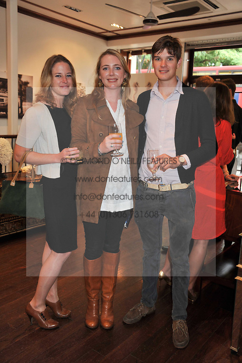 Left to right, LUCY WALKER, FLORENCE HOUSTON and HUMPHREY TEAKLE at a party to celebrate the launch of the new Mauritius Collection of jewellery by Forbes Mavros held at Patrick Mavros, 104-106 Fulham Road, London SW3 on 5th July 2011.