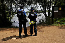 © Licensed to London News Pictures. 1st August 2013. Ducklington Lake, Witney, Oxfordshire. Last night a man in his 30s went missing after swimming in Ducklington lake. Police divers have been searching the lake to find him but so far have not found a body. Photo credit : MarkHemsworth/LNP