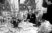 Milton Petrie sitting  at a benefit for the Boys Club of New York. Spring Dance. Plaza hotel. New York. 26 April 1990.  © Copyright Photograph by Dafydd Jones 66 Stockwell Park Rd. London SW9 0DA Tel 020 7733 0108 www.dafjones.com