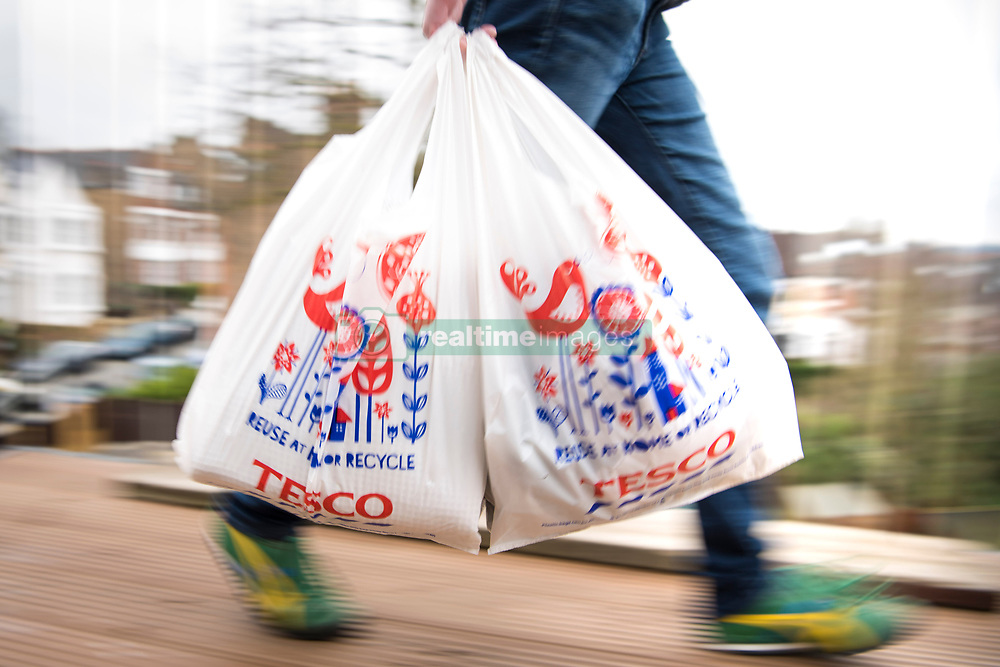 A shopper carrying Tesco bags. Tesco is currently the 8th most valuable British brand, according to analysts Brand Finance's directory. Picture date: Friday March 10, 2017. Photo credit should read: Matt Crossick/ EMPICS Entertainment.