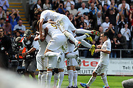 Swansea city players mob Danny Graham after he scores the 3rd goal. Barclays Premier league, Swansea city  v West Ham Utd at the Liberty Stadium in Swansea, South Wales  on Saturday 25th August 2012. pic by Andrew Orchard, Andrew Orchard sports photography,