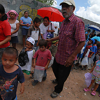 Aug 12, 2010 - Reynosa, Mexico - ROBERTO RODRIGUEZ ushers children into the line towards the distribution point in Satelite Uno. Roberto Rodriguez has been working with the border relief since he was a child, He helped translate for Frank Ferree in the colonia's around Reynosa and after his mother died he was adopted by Frank Ferree. Ferree brought him over to the states and where after Ferree's death in 1983 Roberto became manager of the group, later working along side Dianne Hurman when she became Director. (Credit Image: © Josh Bachman/ZUMA Press)