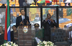 60820469  <br /> This photo taken on Dec. 10, 2013 shows a fake interpreter (R) interpreting with hand signals for U.S. President Barack Obama (L) during the memorial service at the FNB Stadium in Johannesburg. A manhunt has been launched for a fake interpreter who gesticulated gibberish during the memorial service honoring former South African President Nelson Mandela, authorities said on Wednesday, Tuesday, 10th December 2013. Picture by  imago / i-Images<br /> UK ONLY