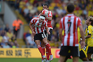 Cedric Soares of Southampton and Steven Caulker of Southampton collide into each other as they attempt to head the same ball. Barclays Premier League, Watford v Southampton at Vicarage Road in London on Sunday 23rd August 2015.<br /> pic by John Patrick Fletcher, Andrew Orchard sports photography.