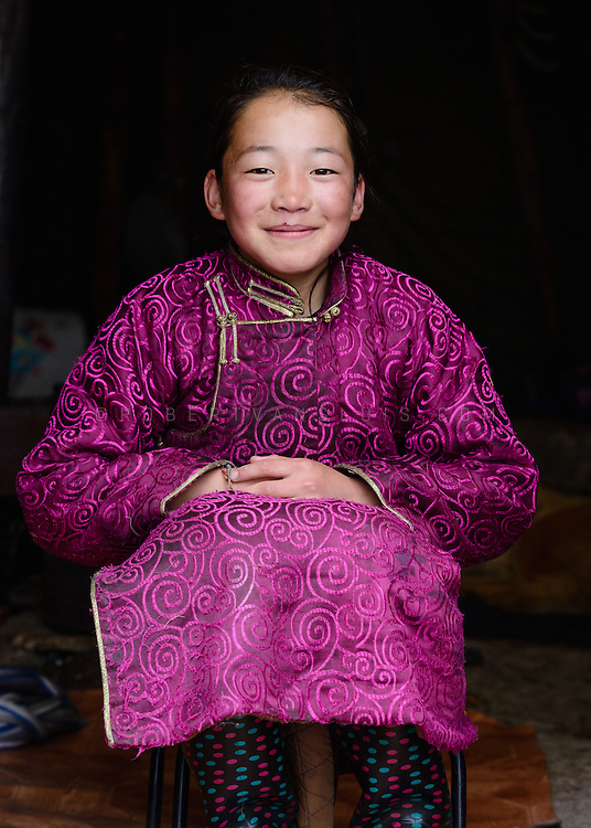 Portrait of a Dukha (Tsaatan) reindeer herder girl in the opening of an ortz (teepee), Mongolia. Approximately 200 families comprise the Tsaatan or Dukha community in northwestern Mongolia, whose existence is intimately linked to their herds of reindeer. Photo © Robert van Sluis