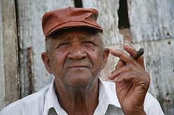Old man in Cuba smoking a cigar,