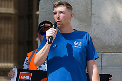Matthew Tovey, a NHS Wales nurse from Merthyr Tydfil, addresses fellow NHS workers from the grassroots NHSPay15 campaign outside Parliament before a march to 10 Downing Street to present his petition signed by over 800,000 people calling for a 15% pay rise for NHS workers on 20th July 2021 in London, United Kingdom. At the time of presentation of the petition, the government was believed to be preparing to offer NHS workers a 3% pay rise in 'recognition of the unique impact of the pandemic on the NHS'.