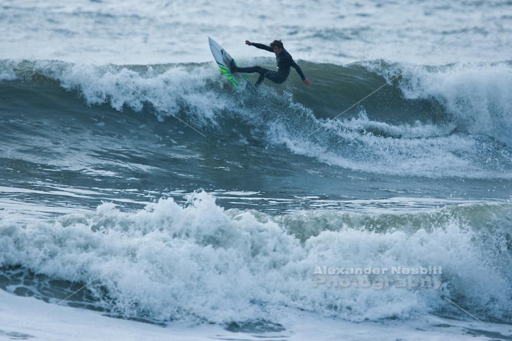 Newport, RI - Surfing at Bailey's beach in the massive swells of Hurricane Sandy