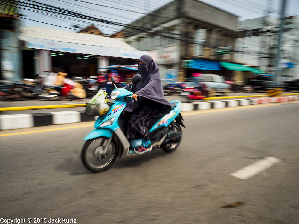 15 JUNE 2105 - NARATHIWAT, NARATHIWAT, THAILAND: People on motorcycles in the market in Narathiwat.       PHOTO BY JACK KURTZ