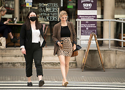© Licensed to London News Pictures. 11/05/2021. London, UK. Television presenter RACHEL RILEY (right) arrives at The Royal Courts of Justice in London where she is currently suing Labour Party staff member Laura Murray for libel over a social media post. Photo credit: Ben Cawthra/LNP