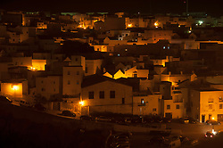 View of whitewashed village houses at night