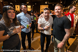 Larry Au, Tim Harney and Roland Sands at the Friday night opening of the Handbuilt Motorcycle Show. Austin, TX. April 10, 2015.  Photography ©2015 Michael Lichter.
