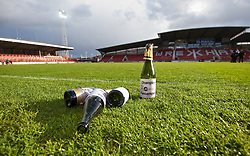 WREXHAM, WALES - Monday, May 2, 2016: Empty champagne bottle left on the field after the 129th Welsh Cup Final at the Racecourse Ground. (Pic by David Rawcliffe/Propaganda)