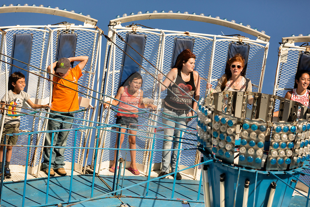 Children hang on as they ride the Zero Gravity amusement ride at Cheyenne Frontier Days July 25, 2015 in Cheyenne, Wyoming. Frontier Days celebrates the cowboy traditions of the west with a rodeo, parade and fair.