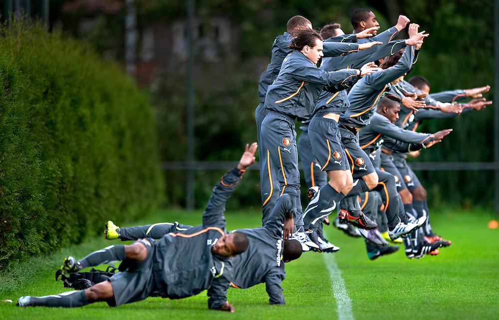 The Netherlands, Rotterdam, 16-09-2010.<br /> Football, National, Eredivisie, Feyenoord.<br /> The selection of Feyenoord during the training with Ricky van Haaren, jumping in front, on the Feyenoord training complex Varkenoord.<br /> Photo : Klaas Jan van der Weij