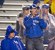 Kentucky Wildcat fans cheer in the rain during the second half of a game against the Arkansas Razorbacks at Donald W. Reynolds Razorback Stadium in Fayetteville, Ark., on Oct.. 13, 2012. Photo by Beth Hall