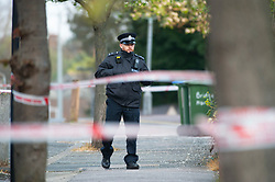 © Licensed to London News Pictures. 10/04/2019.<br /> Mottingham, UK. A police cordon is in place with police on guard this morning. A man in his twenty's was attacked and stabbed yesterday during a moped robbery in Mottingham, South East London. The man is in hospital in a critical condition.  Photo credit: Grant Falvey/LNP